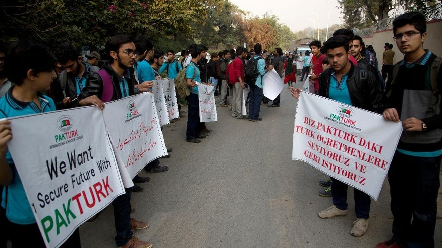 Pakistani students Pak-Turk schools protest against government decision to expel Turk nationals, in Islamabad, Pakistan, Thursday, Nov. 17, 2016. Pakistan's order for 400 Turkish nationals, mostly schoolteachers and their families, to leave the country within 72 hours was being challenged in court on Thursday as hundreds of students took to the streets to denounce the expulsions. (AP Photo/B.K. Bangash)