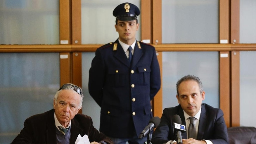 Prosecutor Pietro Forno, left, is flanked by Digos executive Claudio Ciccimarra as they attend a news conference at the Milan's court, Italy, Friday, Nov. 18, 2016. Milan prosecutors say they are investigating a former Moroccan resident of Italy, now living in Iraq, as a foreign fighter for Islamic State. (AP Photo/Luca Bruno)