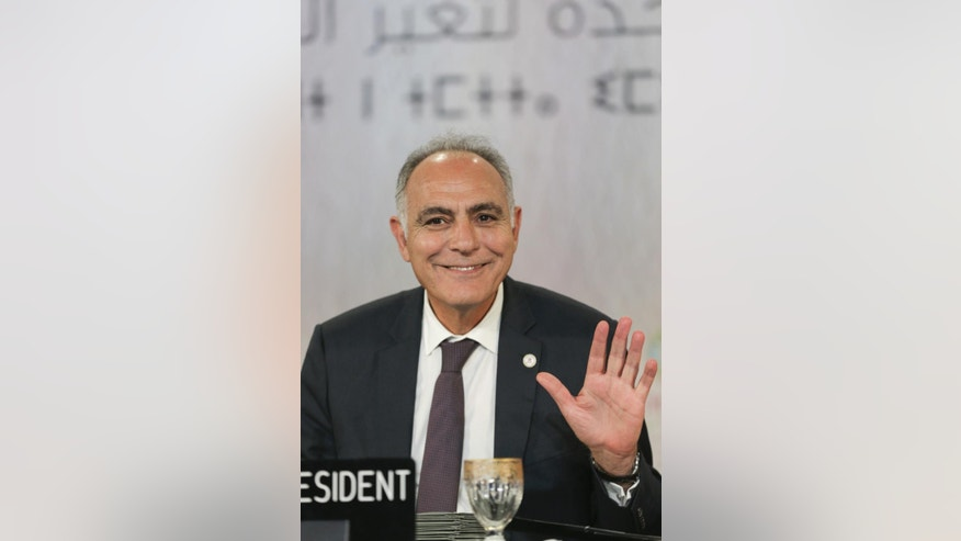 "Morocco's Foreign Minister Salaheddine Mezouar, waves to journalists after the proclamation of Marrakech, at the COP22 climate change conference, in Marrakech, Morocco, Thursday, Nov. 17, 2016. Governments meeting for U.N. climate talks have reiterated their commitment to the Paris Agreement with a proclamation saying climate action is ""irreversible,"" the buzzword at the two-week conference after the uncertainty caused by the U.S. election. (AP Photo/Mosa'ab Elshamy)"