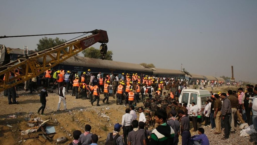Rescuers work at the site of a train derailment accident in Kanpur Dehat, India, Sunday, Nov. 20, 2016. Many were killed Sunday when 14 coaches of an overnight passenger train rolled off the track in northern India, with rescue workers using cutting torches to try to pull out survivors, police said. (AP Photo/Rajesh Kumar Singh)