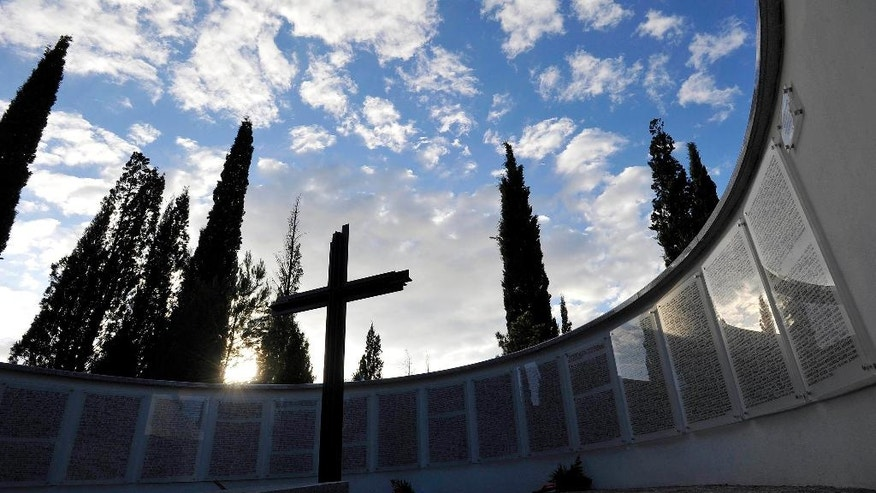 A monument with the names of German soldiers who died during World War II at the war cemetery during funeral service of their mortal remains, in the village of Golubovci, about 10 kilometers (6 miles) south of the Montenegro capital Podgorica, Sunday, Nov. 19, 2016. Officials have inaugurated a cemetery for hundreds of German soldiers killed in Montenegro during World War II hailing it as an act of reconciliation that is important for the future. (AP Photo/Risto Bozovic)