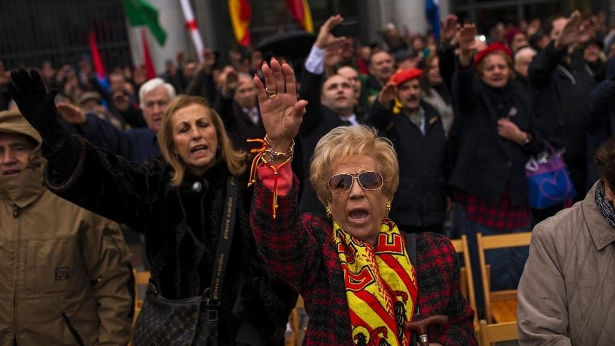 Fascists and extreme far right wing supporters, gesture, during a rally commemorating former Spanish dictator Francisco Franco's death in Madrid, Sunday, Nov. 20, 2016. Hundreds of Spaniards nostalgic for the nation's fascist dictatorship gathered in a Madrid square on Sunday to commemorate the 41st anniversary of Francisco Franco's death. (AP Photo/Francisco Seco)