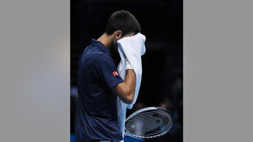 Novak Djokovic of Serbia wies thesweat of his face during the ATP World Tour Finals singles final tennis match against Andy Murray of Britain at the O2 Arena in London, Sunday, Nov. 20, 2016. (AP Photo/Kirsty Wigglesworth)