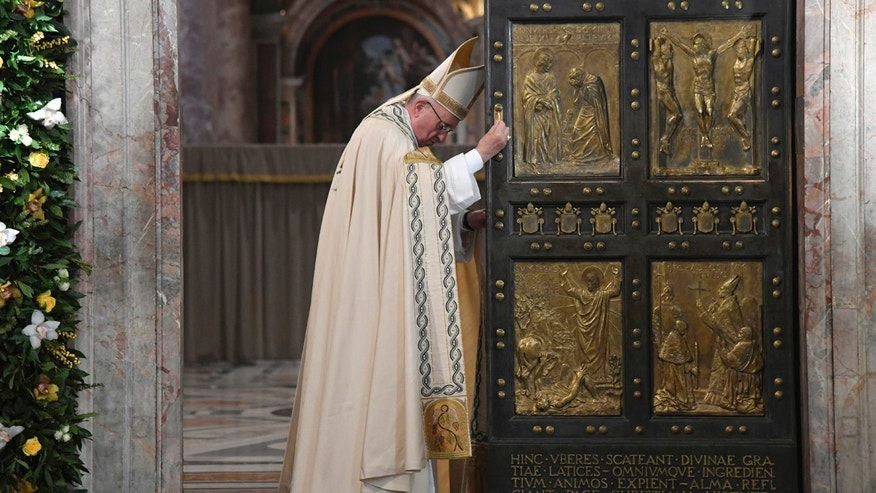 Pope Francis closes the Holy Door of St. Peter's Basilica at the Vatican, Sunday, Nov. 20, 2016. Pope Francis has pulled shut the Holy Door of St. Peter's Basilica, formally ending the Holy Year of Mercy he declared to highlight that virtue. (Tiziana Fabi/pool photo via AP)