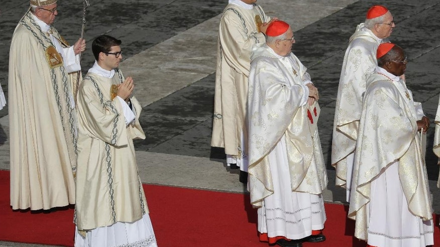 Pope Francis, left, arrives for a Mass on the occasion of the closing of the Holy Door of St. Peter's Basilica at the Vatican, Sunday, Nov. 20, 2016. The Holy Door closing marks the end of the Jubilee of Mercy. (AP Photo/Gregorio Borgia)