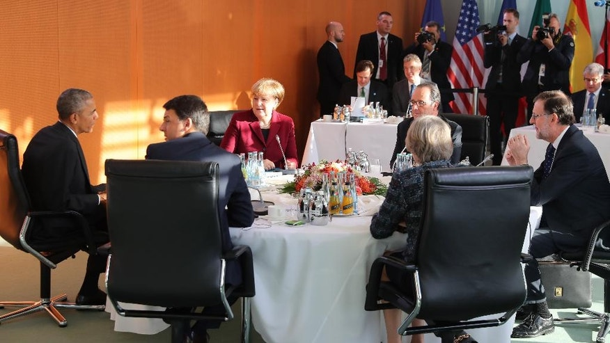 German chancellor Angela Merkel, third left, attends a meeting with US president Barack Obama, left, French president, Francois Hollande, third right, Spain's Prime Minister , Mariano Rajoy, right, Britain's  Prime Minister  Theresa May, second right,  and Italian Prime Minister  Matteo Renzi, second left, at the chancellary in Berlin, Friday Nov.18, 2016.  Obama is joining the leaders of key European countries to discuss an array of security and economic challenges facing the trans-Atlantic partners as the U.S. prepares for President-elect Donald Trump to take office in January. (Kay Nietfeld/Pool Photo via AP)