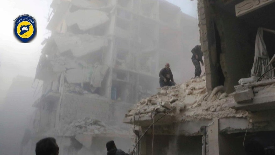 This photo provided by the Syrian Civil Defense White Helmets, which has been authenticated based on its contents and other AP reporting, shows Syrian citizens inspect damage buildings after airstrikes hit the Seif al-Dawleh neighborhood in Aleppo, Syria, Saturday, Nov. 19, 2016. Government bombardment of besieged rebel-held neighborhoods in the northern city of Aleppo killed at least 20 people Saturday Syrian opposition activists said, a day after the health directorate said all hospital in opposition areas have been knocked out of service. (Syrian Civil Defense White Helmets via AP)