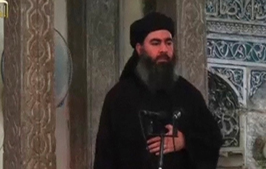 A man purported to be the reclusive leader of the militant Islamic State Abu Bakr al-Baghdadi has made what would be his first public appearance at a mosque in the centre of Iraq's second city, Mosul, according to a video recording posted on the Internet on July 5, 2014, in this still image taken from video. There had previously been reports on social media that Abu Bakr al-Baghdadi would make his first public appearance since his Islamic State in Iraq and the Levant (ISIL) changed its name to the Islamic State and declared him caliph. The Iraqi government denied that the video, which carried Friday's date, was credible. It was also not possible to immediately confirm the authenticity of the recording or the date when it was made. REUTERS/Social Media Website via Reuters TV (IRAQ - Tags: POLITICS) ATTENTION EDITORS - THIS IMAGE HAS BEEN SUPPLIED BY A THIRD PARTY. IT IS DISTRIBUTED, EXACTLY AS RECEIVED BY REUTERS, AS A SERVICE TO CLIENTS. REUTERS IS UNABLE TO INDEPENDENTLY VERIFY THE CONTENT OF THIS VIDEO, WHICH HAS BEEN OBTAINED FROM A SOCIAL MEDIA WEBSITE - RTR3X9BH