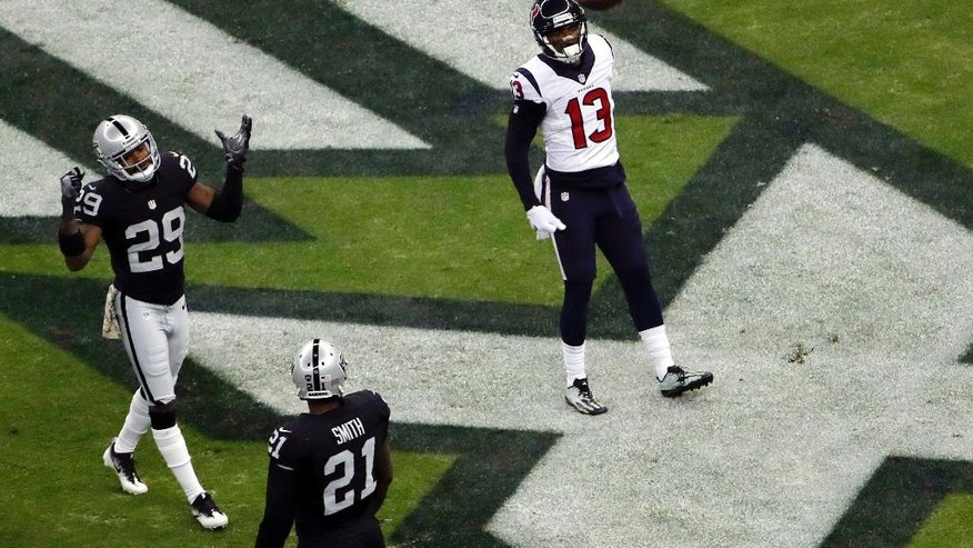 Houston Texans wide receiver Braxton Miller (13) celebrates after scoring a touchdown as Oakland Raiders cornerback David Amerson (29) and teammate cornerback Sean Smith (21) react during the first half of an NFL football game Monday, Nov. 21, 2016, in Mexico City. (AP Photo/Dario Lopez-Mills)