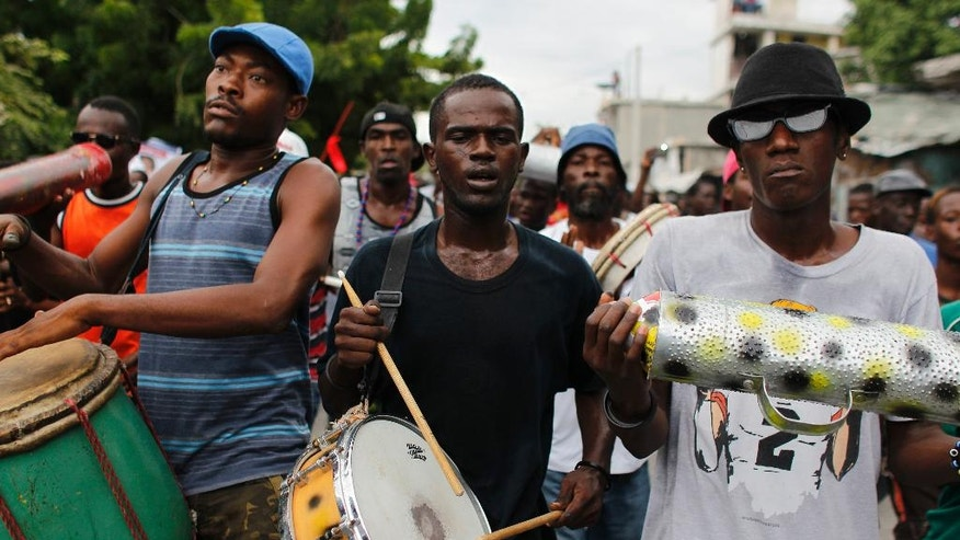 Supporters of presidential candidate Maryse Narcisse from Fanmi Lavalas political party play music during a protest in Port-au-Prince, Haiti, Monday, Nov. 21, 2016. Haiti's repeatedly derailed presidential election finally went off relatively smoothly Sunday as the troubled nation tries to get its shaky democracy on a firmer foundation after nearly a year of being led by a provisional government. (AP Photo/Ricardo Arduengo)