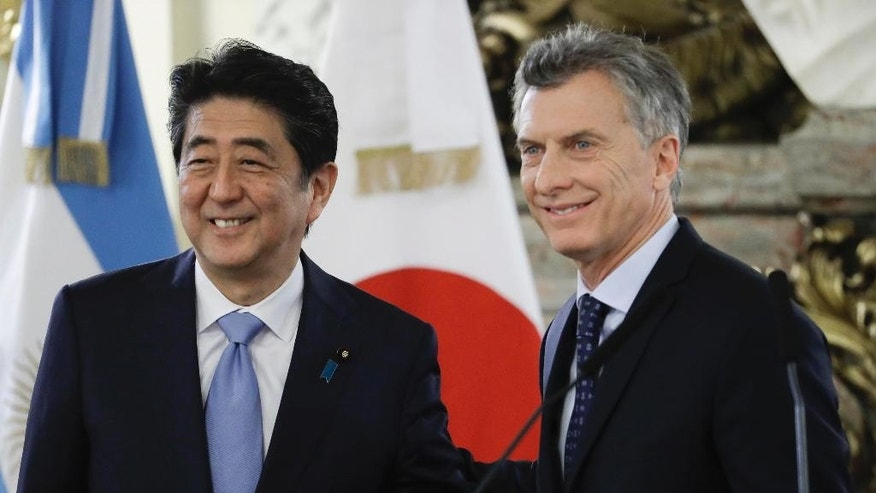 Japan's Prime Minister Shinzo Abe, left, poses for a picture with Argentina's President Mauricio Macri at the government house in Buenos Aires, Argentina, Monday, Nov. 21, 2016. Abe is on an official visit to Argentina after attending the Asia-Pacific Economic Cooperation summit in Peru. (AP Photo/Natacha Pisarenko)
