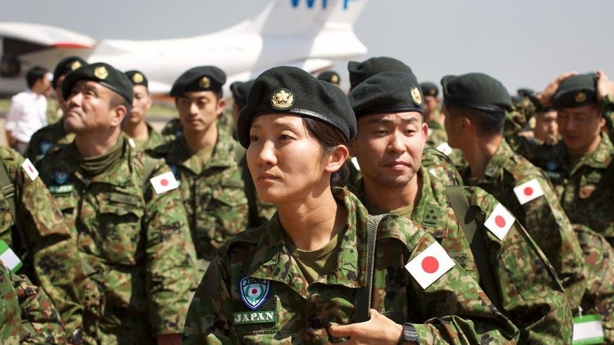 Members of the Japan Self-Defense Forces arrive as part of a first batch who have a broader mandate to use force, at the airport in Juba, South Sudan Monday, Nov. 21, 2016. Japanese peacekeepers, with a broader mandate to use force, landed in South Sudan in the first such deployment of the country's troops overseas with those expanded powers in nearly 70 years. (AP Photo/Justin Lynch)