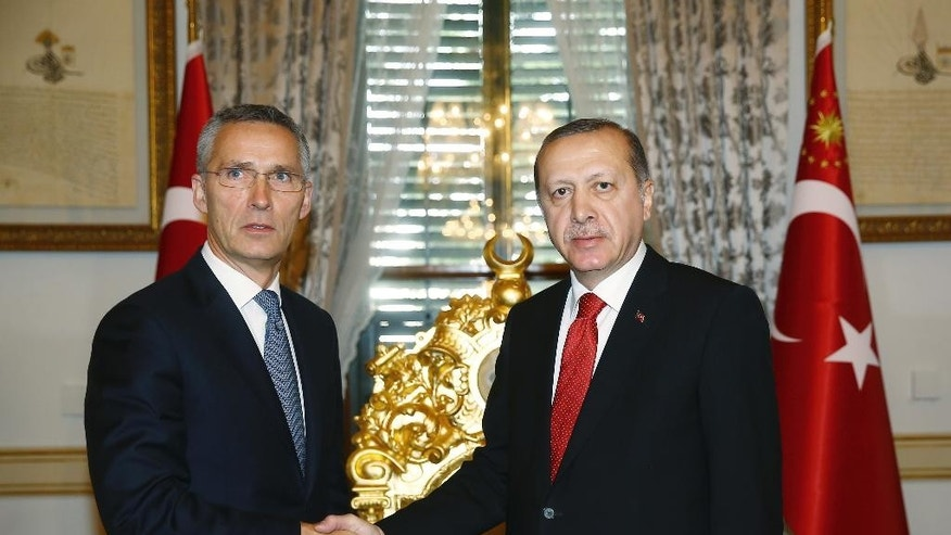 """Turkey's President Recep Tayyip Erdogan, right, and NATO Secretary General Jens Stoltenberg shake hands before a meeting in Istanbul, Monday, Nov. 21, 2016.  Speaking at the NATO summit in Istanbul, Stoltenberg said he is """"looking forward"""" to working with Donald Trump's upcoming U.S. administration and reiterated the trans-Atlantic alliance's dedication to increasing funds from non-U.S. members. (Kayhan Ozer, Presidential Press Service, Pool photo via AP )"""