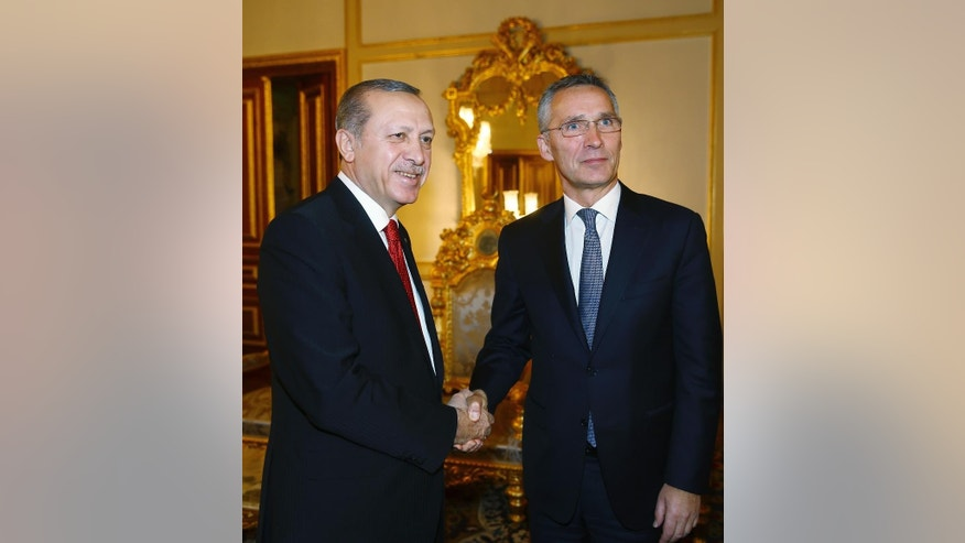 """Turkey's President Recep Tayyip Erdogan, left, and NATO Secretary General Jens Stoltenberg shake hands before a meeting in Istanbul, Monday, Nov. 21, 2016. Speaking at the NATO summit in Istanbul, Stoltenberg said he is """"looking forward"""" to working with Donald Trump's upcoming U.S. administration and reiterated the trans-Atlantic alliance's dedication to increasing funds from non-U.S. members. (Kayhan Ozer, Presidential Press Service, Pool photo via AP )"""