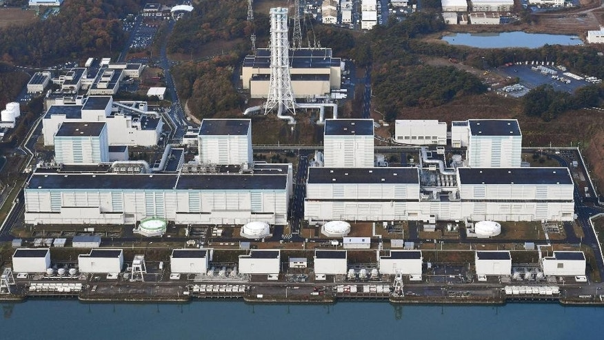 This aerial photo shows Fukushima Dai-ni nuclear power plant in Futaba, Fukushima Prefecture following a strong earthquake Tuesday, Nov. 22, 2016. Plant operator TEPCO said a pump that supplies cooling water to a spent fuel pool at No. 3 reactor, second right, of the plant stopped working, but that a backup pump had been launched to restore cooling water to the pool. (Kyodo News via AP)