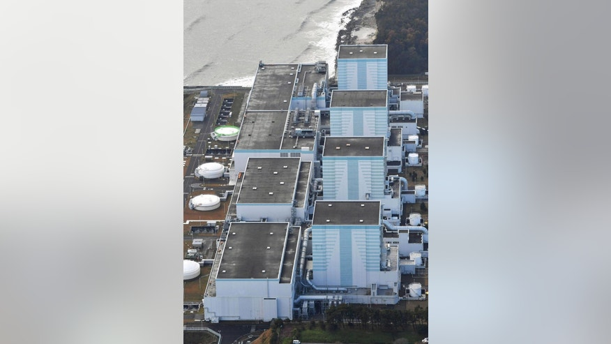 This aerial photo shows Fukushima Dai-ni nuclear power plant in Futaba, Fukushima Prefecture following a strong earthquake Tuesday, Nov. 22, 2016. Plant operator TEPCO said a pump that supplies cooling water to a spent fuel pool at No. 3 reactor, second from bottom, of the plant stopped working, but that a backup pump had been launched to restore cooling water to the pool. (Kyodo News via AP)