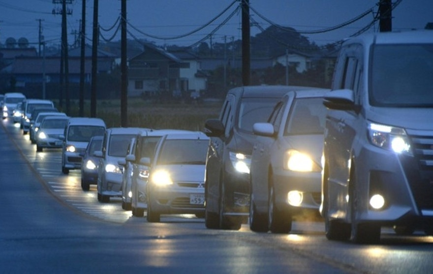 Vehicles make a line as they flee following a tsunami warning in Iwaki, Fukushima prefecture early Tuesday, Nov. 22, 2016. Coastal residents in Japan were ordered to flee to higher ground on Tuesday after a strong earthquake struck off the coast of Fukushima prefecture. (Kyodo News via AP)