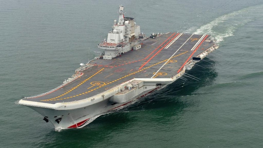 FILE - In this May 2012 file photo provided by China's Xinhua News Agency, Chinese aircraft carrier Liaoning cruises for a test in the sea. China's first aircraft carrier is now ready to engage in combat, marking a milestone for a navy that has invested heavily in its ability to project power far from China's shores. (AP Photo/Xinhua, Li Tang, File)