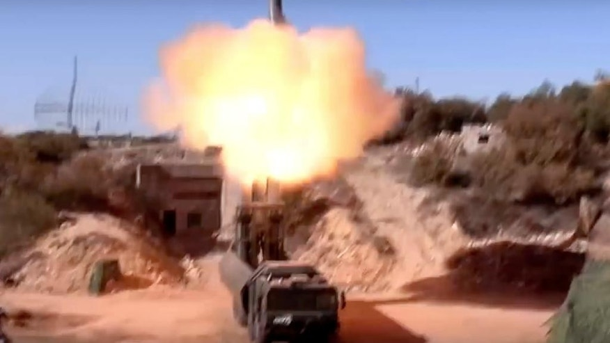 In this photo taken on Tuesday, Nov. 15, 2016 and made from the video footage taken from Russian Defense Ministry official web site, the Russian military launches a missile from a Bastion missile launcher in Syria. The Interfax reported Monday Nov. 21, 2016, that the military has put Bastion missile-launchers on duty in the Kaliningrad exclave in the nation's westernmost Baltic region that borders NATO members Poland and Lithuania.(Russian Defense Ministry Press Service/ Photo via AP)