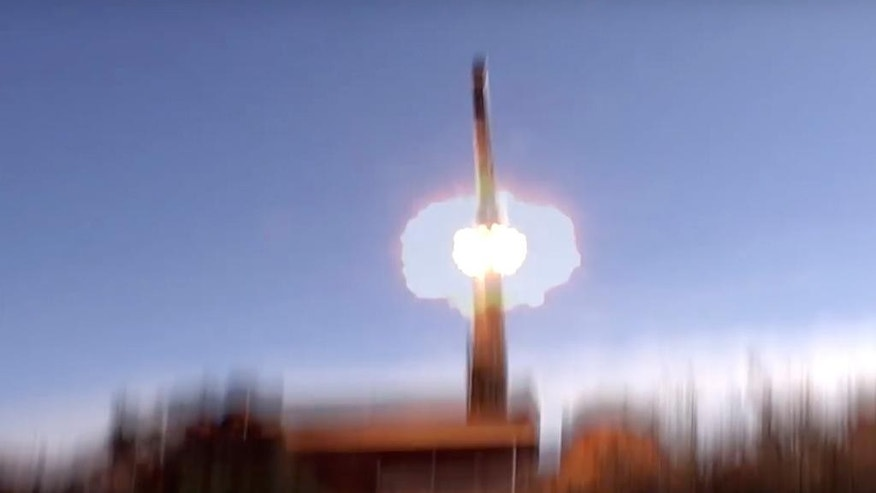 In this photo taken on Tuesday, Nov. 15, 2016 and made from the video footage taken from Russian Defense Ministry official web site, the Russian military launches a missile from the Bastion missile launcher in Syria. The Interfax reported Monday Nov. 21, 2016, that the military has put Bastion missile-launchers on duty in the Kaliningrad exclave in the nation's westernmost Baltic region that borders NATO members Poland and Lithuania. (Russian Defense Ministry Press Service/ Photo via AP)