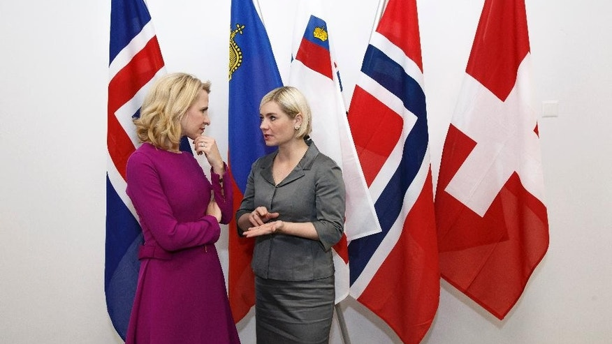 Liechtenstein's Minister of Foreign Affairs Aurelia Frick, left, speaks with Iceland's Minister for Foreign Affairs and External Trade Lilja Alfredsdottir, right, prior an EFTA Ministerial meeting at the headquarters of the European Free Trade Association, EFTA, in Geneva, Switzerland, Monday, Nov. 21, 2016. (Salvatore Di Nolfi/Keystone via AP)