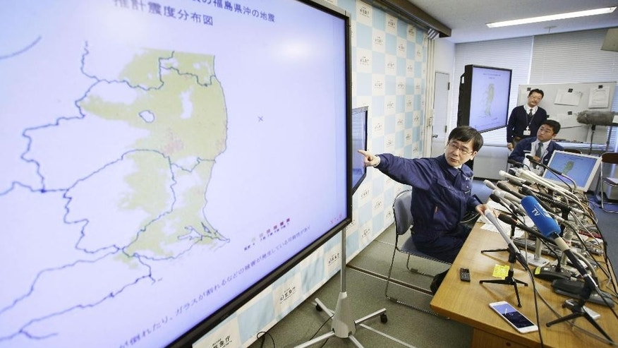 Japan Meteorological Agency earthquake expert Koji Nakamura points a map of Fukushima and its surrounding prefectures during a press conference in Tokyo on a strong earthquake with a magnitude of 7.4 that struck off the coast of Fukushima Tuesday, Nov. 22, 2016. Coastal residents in Japan were ordered to flee to higher ground after the quake. The agency issued a tsunami warning for waves of up to 3 meters (10 feet) in Fukushima, north of Tokyo, which is home to the nuclear power plant that was destroyed by a huge tsunami following an offshore earthquake in 2011. There were no immediate reports of damage or injury. (Yosuke Mizuno/Kyodo News via AP)