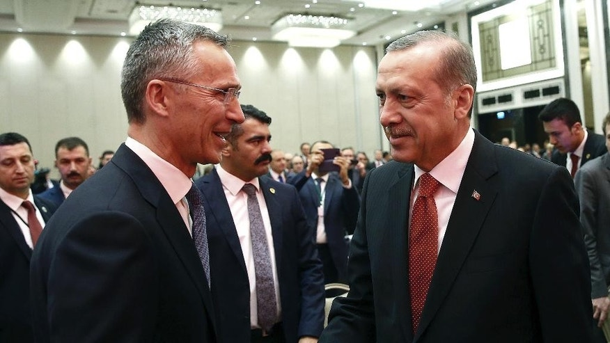 Turkey's President Recep Tayyip Erdogan, right, and NATO Secretary General Jens Stoltenberg shake hands as they attend a NATO parliamentary assembly meeting in Istanbul, Monday, Nov. 21, 2016. Erdogan has called on the United States and other nations to re-assess his country's proposal for the creation of a no-fly zone in northern Syria. Addressing the NATO meeting, Erdogan again criticized allies' reliance on Syrian Kurdish fighters to battle the Islamic State group.(Kayhan Ozer, Presidential Press Service, Pool photo via AP)