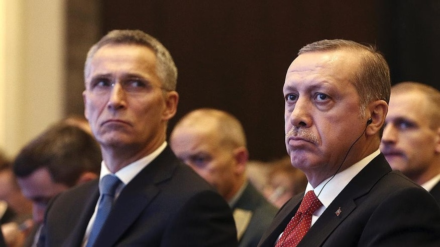 Turkey's President Recep Tayyip Erdogan, right, and NATO Secretary General Jens Stoltenberg attend a NATO parliamentary assembly meeting in Istanbul, Monday, Nov. 21, 2016. Erdogan has called on the United States and other nations to re-assess his country's proposal for the creation of a no-fly zone in northern Syria. Addressing the NATO meeting, Erdogan again criticized allies' reliance on Syrian Kurdish fighters to battle the Islamic State group. (Kayhan Ozer, Presidential Press Service, Pool photo via AP)