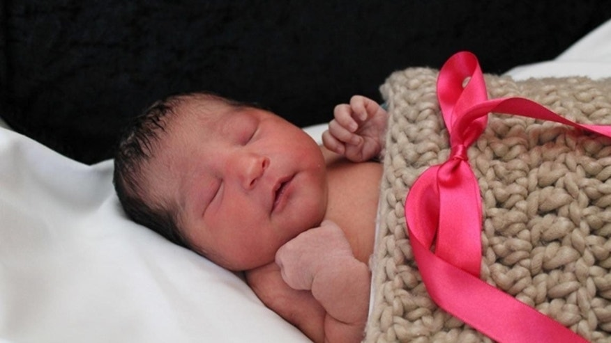 CORRECTS SPELLING OF FIRST NAME FROM SOFIA TO SOPHIA - This photo provided by the Wichita Police shows Sophia Victoria Gonzalez Abarca, a missing week-old baby in Wichita, Kan.  Police in Kansas say the week-old newborn girl who went missing after her mother was shot to death has been found alive in Dallas. Chief Gordon Ramsay said Saturday, Nov. 19, 2016 that suspects in the death of 27-year-old Laura Abarca-Nogueda took the child and fled to Texas, where Sophia Victoria Gonzalez Abarca was found safe. Ramsay said two people are in custody.   (Wichita Police via AP)