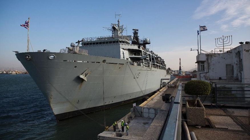 The British Royal Navy amphibious assault ship HMS Bulwark is anchored in Haifa port, Israel, Tuesday, Nov. 22, 2016. The Bulwark is on a mission in the Mediterranean sea. (AP Photo/Ariel Schalit)