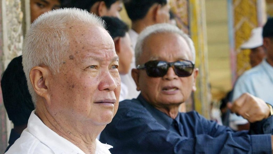 "FILE - In this July 3, 2003 file photo, former Khmer Rouge leaders Khieu Samphan, left, and Nuon Chea sit together during funeral services for Khieu Ponnary, the first wife of Khmer Rouge leader Pol Pot, in the former Khmer Rouge stronghold of Pailin, northwestern Cambodia.   A top Cambodian court has upheld the life sentences of the two most senior surviving members of the Khmer Rouge regime, which was responsible for the deaths of 1.7 million people. The Supreme Court Chamber said the 2014 verdict by a U.N.-assisted Khmer Rouge tribunal was ""appropriate"" given the gravity of the crimes and roles of the two defendants — Khieu Samphan, the 85-year-old Khmer Rouge head of state, and Nuon Chea, the 90-year-old right-hand man to the communist group's late leader Pol Pot. The verdict was read out Wednesday, Nov. 23, 2016.(AP Photo/Andy Eames, File)"