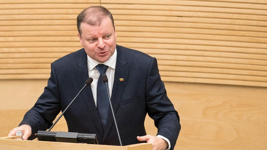Lithuania's Peasant and Green's Union (LPGU) party leader Salius Skvernelis speaks in parliament in Vilnius, Lithuania, Tuesday, Nov. 22, 2016. Lithuania's parliament approved Skvernelis as the new prime minister on Tuesday. (AP Photo/Mindaugas Kulbis)