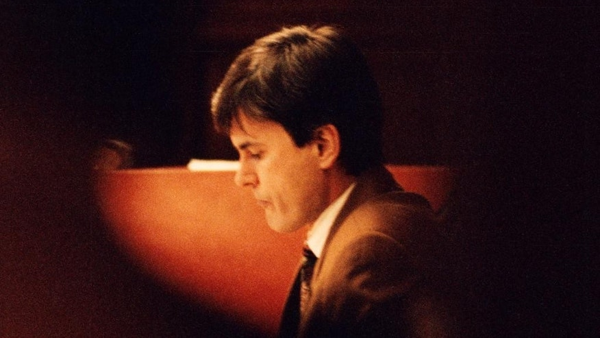 """FILE - This is a Feb.  2, 1995 file photo of John Ausonius during a trial in the district court in Stockholm. Germany has asked Sweden to extradite John Ausonius one of its most notorious prisoners to stand trial in the murder of a Jewish woman in Frankfurt in 1992. Dubbed """"Laserman"""" for the gunsight he used,  Ausonius is serving a life sentence in Sweden for a series of shootings of immigrants in the 1990s. He was convicted of one murder and nine attempted murders. (Tobias Rostlund/TT, File Via AP)"""
