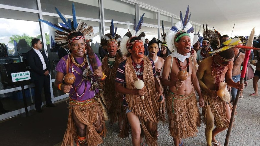 Pataxo indigenous perform a ritual dance as they block the main entrance of Planalto presidential palace as a form of protest in Brasilia, Brazil, Tuesday, Nov. 22, 2016. Brazil's various indigenous groups are demanding the government recognize their ancestral lands and provide group land titles. (AP Photo/Eraldo Peres)