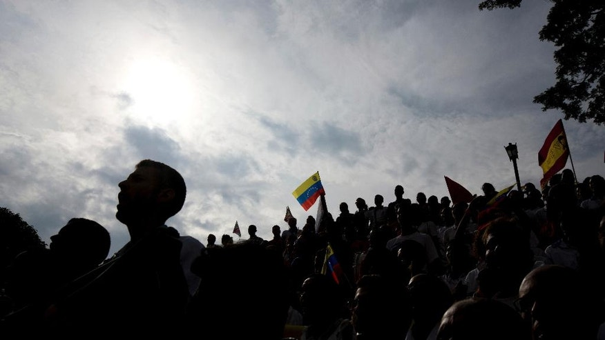 Students sing their national anthem during a rally outside Miraflores presidential palace, where Venezuela's President Nicolas Maduro addressed them in Caracas, Venezuela, Monday, Nov. 21, 2016. The event marked national Student Day. (AP Photo/Fernando Llano)