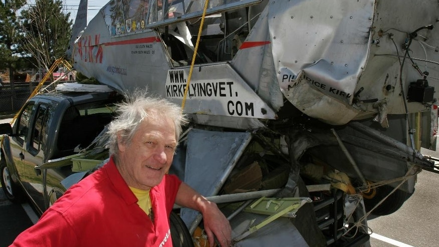 "FILE - In this Tuesday, May 1, 2007 file photo, Maurice Kirk stands next to his damaged World War II-era plane, ""Liberty Girl"", which he then planned to have restored, in Freeport, Maine. The organizers of a rally of vintage planes flying across Africa say the British pilot Maurice Kirk, 72, went missing Tuesday, Nov. 22, 2016 while flying his 1943 Piper Cub plane and had not arrived at his expected destination in Gambella, Ethiopia. (AP Photo/Pat Wellenbach, File)"