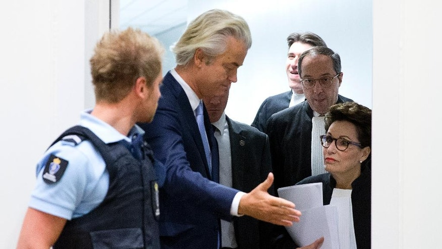 Populist anti-Islam lawmaker Geert Wilders, second left, waits for a member of his legal team to enter the high-security court near Schiphol Airport, Amsterdam, Wednesday, Nov. 23, 2016, to attend his hate-speech trial that pits freedom of expression against the Netherlands' anti-discrimination laws. Rear second right is Wilders' lawyer Geert-Jan Knoops. (AP Photo/Peter Dejong)