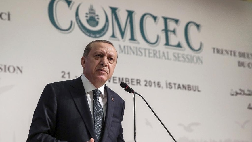 "Turkey's President Recep Tayyip Erdogan addresses an annual economy and trade meeting of the Organization for Islamic Cooperation in Istanbul, Wednesday, Nov. 23, 2016. Erdogan declared Wednesday that an upcoming vote in the European Parliament on whether to freeze membership talks with Turkey is of ""no value"" to his country. (Yasin Bulbul, Presidential Press Service,/Pool Photo via AP)"