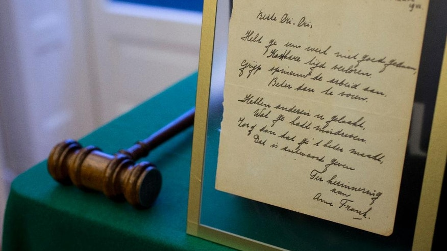 A short poem by Anne Frank, handwritten and dated in Amsterdam on March 28, 1942, is displayed at Bubb Kuyper auction house prior to the auction in Haarlem, Netherlands, Wednesday, Nov. 23, 2016. (AP Photo/Peter Dejong)