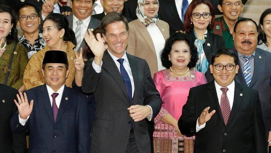 Dutch Prime Minister Mark Rutte, center, waves after a group photo with Indonesian House Speaker Ade Komarudin, front left, his deputy Fadli Zon, front right, and other members of Indonesian House of Representatives during his visit at the parliament building in Jakarta, Indonesia, Wednesday, Nov. 23, 2016. Rutte is currently on a three-day visit to the country. (AP Photo/Achmad Ibrahim)