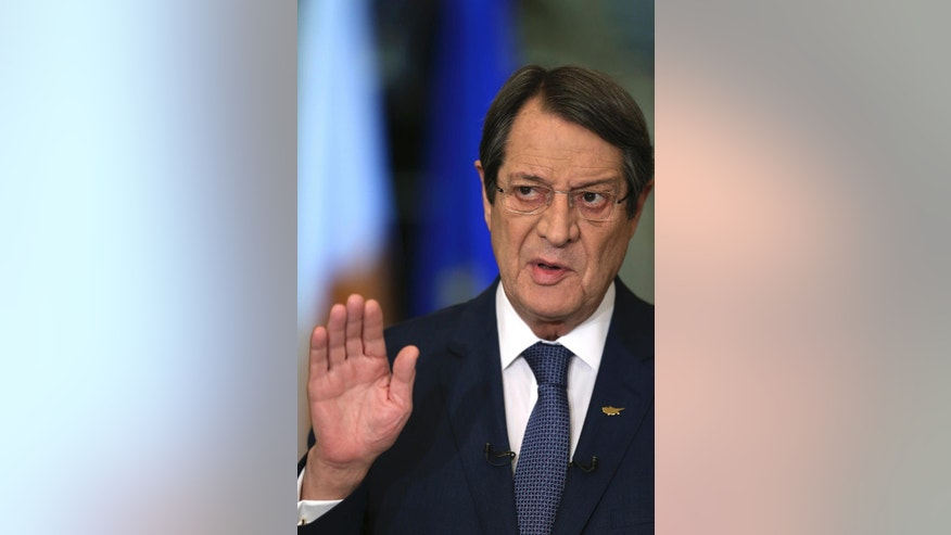 Cyprus President Nicos Anastasiades speaks during a nationally televised news conference at the Presidential Palace in Nicosia, Cyprus, on Wednesday, Nov. 23, 2016. Anastasiades says he's ready to pick up talks with Turkish Cypriots leader aimed at reunifying the ethnically divided island after they hit an impasse earlier this week. (AP Photo/Petros Karadjias, Pool)