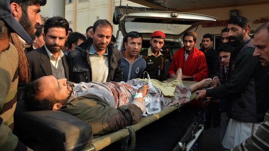 People carry an injured person to a local hospital in Muzaffarabad, capital of Pakistani Kashmir, Wednesday, Nov. 23, 2016. Artillery fire and shelling from India targeted several villages and struck a passenger bus near the dividing line in the disputed region of Kashmir on Wednesday, killing many civilians wounding more than a dozen others, the Pakistani military and officials said. (AP Photo/M.D. Mughal)
