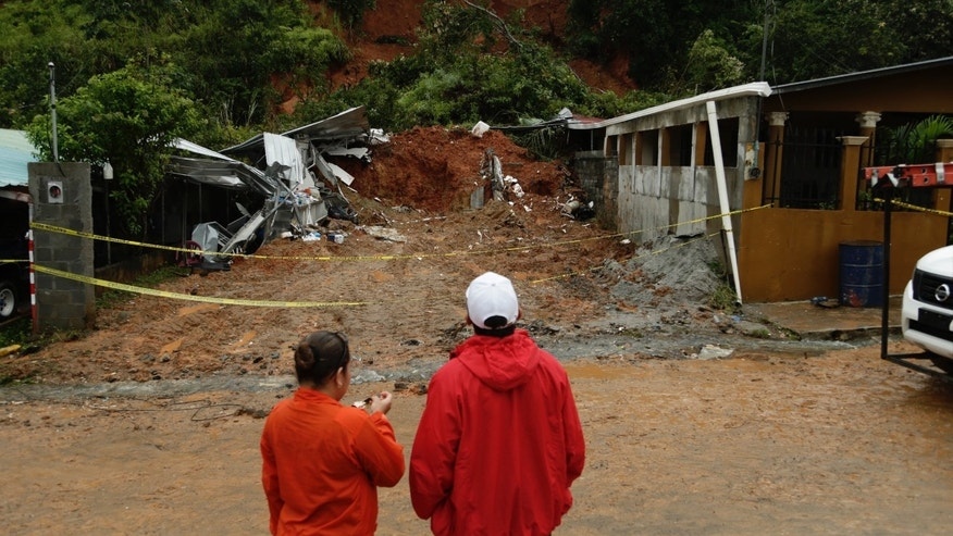 A couple was killed after their home was destroyed by a mudslide on the outskirts of Panama City, Tuesday, Nov. 22, 2016.