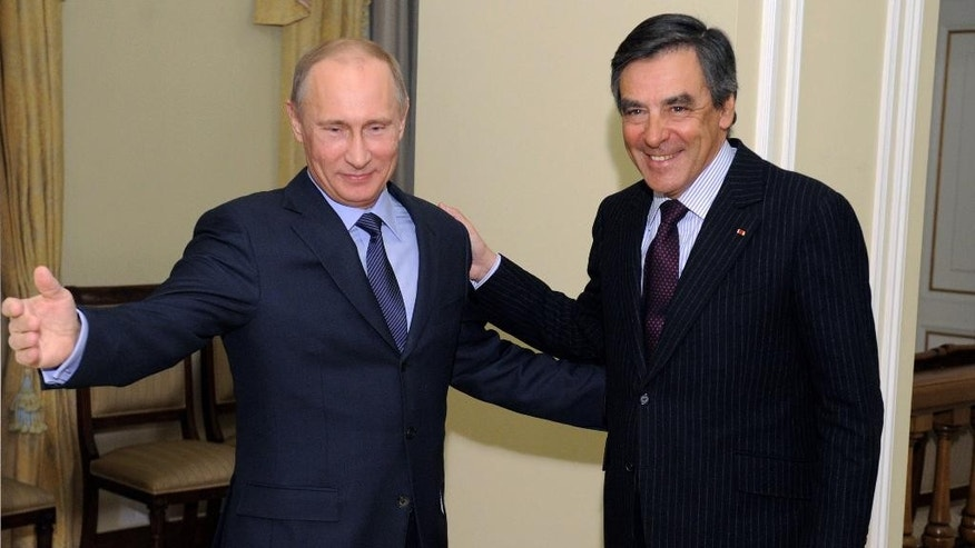 "FILE - In this Thursday, March 21, 2013 file picture Russian President Vladimir Putin, left, meets with former French Prime Minister Francois Fillon in the Novo-Ogaryovo residence outside Moscow. Francois Fillon, who polls suggest is the frontrunner, wants to end sanctions against Russia over its actions in Ukraine, work with Russia to fight the Islamic State group, and insists ""Russia poses no threat to the West."" (AP Photo/RIA-Novosti, Alexei Druzhinin, Presidential Press Service, File)"