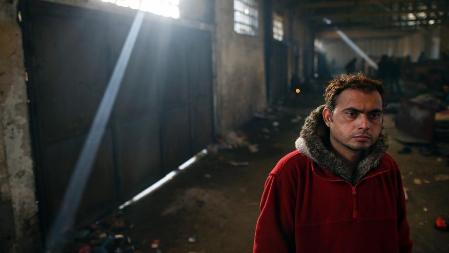 A migrant walks inside of an abandoned warehouse in Belgrade, Serbia, Wednesday, Nov. 23, 2016. About 1,000 migrants occupied the rubbish-strewn sprawling complex in search for protection from cold and rain. (AP Photo/Darko Vojinovic)