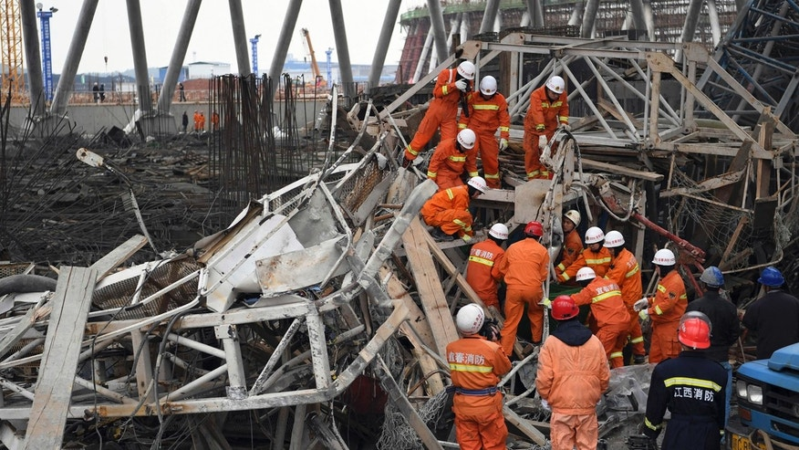 In this photo released by Xinhua News Agency, rescue workers look for survivors after a work platform collapsed at the Fengcheng power plant in eastern China's Jiangxi Province, Nov. 24, 2016.