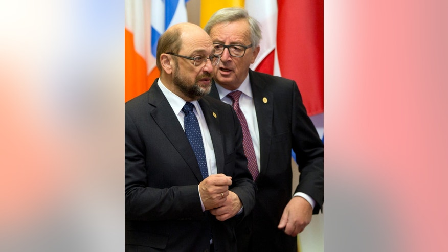 European Commission President Jean-Claude Juncker, right, speaks with European Parliament President Martin Schultz prior to an EU-Ukraine summit at the European Council building in Brussels on Thursday, Nov. 24, 2016. (AP Photo/Virginia Mayo)