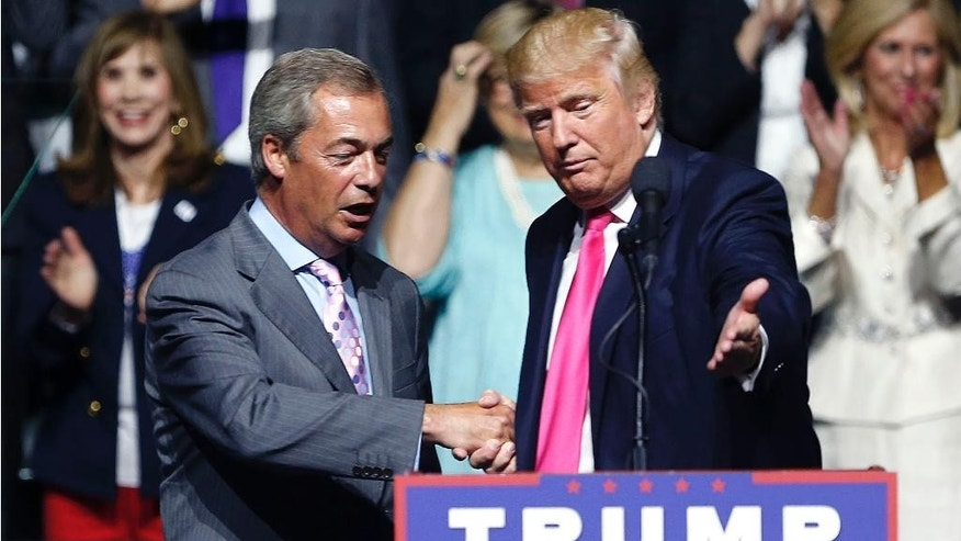 """FILE -In this Wednesday, Aug. 24, 2016 file photo, the then Republican presidential candidate Donald Trump, right, welcomes pro-Brexit British politician Nigel Farage, to speak at a campaign rally in Jackson, Miss. The pro-Brexit leader who is closely allied with U.S. President-elect Donald Trump said late Wednesday there will be a """"seismic shock"""" if Brexit is delayed. (AP Photo/Gerald Herbert, File)"""