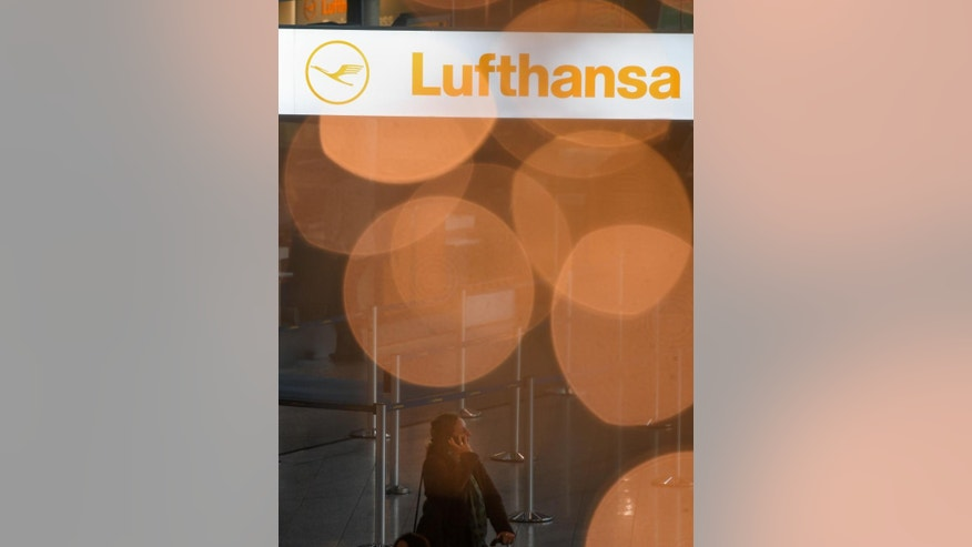 The lights on a Christmas tree form circles in front of a Lufthansa counter in Terminal 1 of the airport in Frankfurt, Germany, Thursday, Nov.  24, 2016 when Lufthansa pilots continue their strike. (Arne Dedert/dpa via AP)