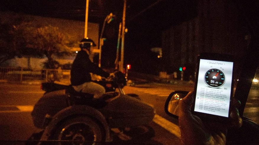 In this Nov. 20, 2016 photo, a sound meter on a mobile phone shows 89 decibels as a motorcycle with a side car drones by on 23rd street in Havana, Cuba. City authorities have passed new city codes meant to make streets around nearly three dozen commercial shopping zones more pleasant both for Cubans and the surging number of foreign tourists. These codes include noise pollution. (AP Photo/Desmond Boylan)
